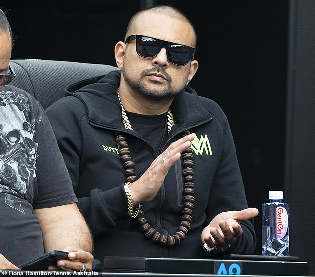Blast from the past! Rapper Sean Paul, 47, (pictured) stepped back into the spotlight as he joined local stars at the Australian Open in Melbourne on Monday
